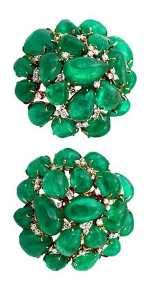 Colombian Emerald Cabochon Cluster Earrings. A stunning pair of emerald earrings set with thirty-eight pear-shape colombian emeralds spaced with fifty-four round, brilliant-cut diamonds. Clip backs with posts.