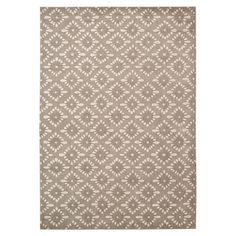Create a stylish foundation for your living room or master suite with this lovely rug, showcasing a diamond motif in a neutral palette.