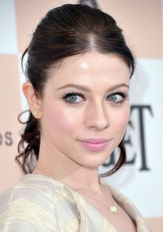 She looks best in soft summer color make-up (muted colors based on blue). no bronzer