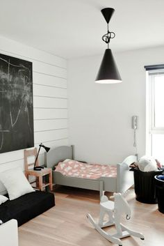 planks on wall, black and white room with gray bed