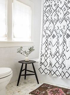 In this bathroom, curated details like a petite Persian rug and a vignette around a small piece of art show that a few thoughtful moments are most necessary to liven up even the smallest and most practical of spaces.