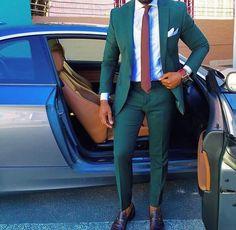Green suit, dark shoes