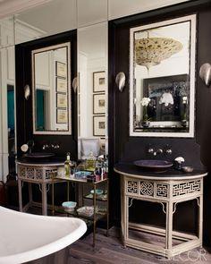 Dark walls + fortuny chandelier + demilune table vanity in unique bathroom of Kim Hersov's London Home via ELLE DECOR