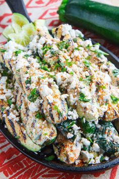 Mexican Street Corn Style Grilled Zucchini-Grilled zucchini topped with mayonnaise, crumbled feta, cilantro, cayenne and lime juice! (Think elotes or Mexican street corn style grilled zucchini!)