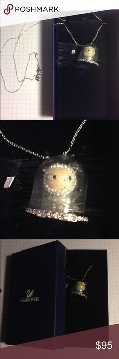 Swarovski Eliot Snow Globe Necklace This is a limited edition necklace from 2011 by Swarovski. It has never been worn. It comes with the original packaging, but without a tag. Feel free to ask for more pictures! Swarovski Jewelry Necklaces