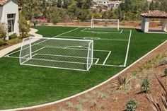 Wouldn't you love to have a soccer field at your house? Check out one of our customers newly installed soccer field. We are sure they are the hit of the neighborhood now! l outdoor living l backyard l curb appeal l go green l sports field l backyard fun Backyard Sports, Backyard For Kids, Backyard Games, Backyard Landscaping, Backyard Ideas, Indoor Soccer Field, Outdoor Basketball Court, Portable Soccer Goals, Football Pitch