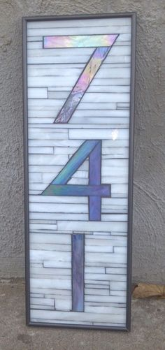 Custom Art Glass Mosaic House Numbers. I like the background. I think I would just mount the chrome numbers to it from the hardware store.