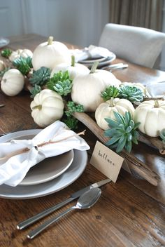 This year we are setting a rustic table for Thanksgiving with succulents, white pumpkins and beautiful sticks. Each napkin is decorated with a small manzanita branches, a subtle ribbon and printable place cards from Paper Source.