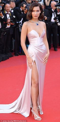 In the nude: Supermodel Bella, 20, first commanded attention in a stunning pink gown, whic...