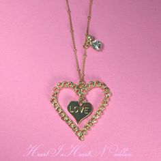 """The accessories which were particular about """"the heart"""" with the plate of the small heart with the carved seal of """"LOVE"""" in a heart-shaped frame. The chain is unique, too, and a ring is given. The accessories in imitation of a pearl and Swarovski are pretty as one point, too.  Size: Chain 62cm - 66cm, heart /3.8 *3.8cm"""