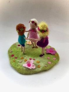 Needle Felted children in a meadow.Hand-felted.