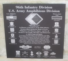 96th Infantry Division plaque in the courtyard of the National Museum of the Pacific War.
