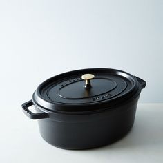 A high-quality, enameled cast-iron dutch oven like this Staub seven-quart oval cocotte ($334) is a budget-b...