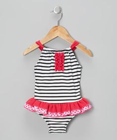 Drenched in darling details, this skirted one-piece will cover swimming sweeties in comfort and style. Dressed with spots, stripes and an adjustable tie in the back, it's the perfect pick for splishing and splashing the day away.