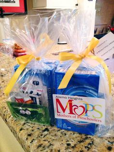 Welcome gift for MOPS - A Beautiful Mess. Kleenex travel packs, Boogie wipes, hand wipes, stain remover wipe...