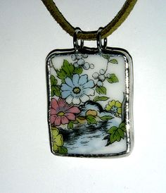 Gorgeous handmade pendant with floral china piece :)  Love it!