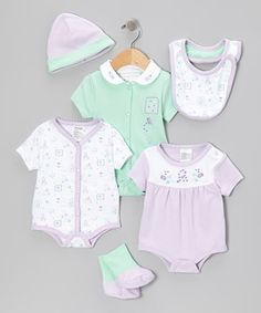 Play peekaboo with little loves in this cozy cotton set. With a lap neck and snaps on the bottom of the bodysuits, fitted construction of the toasty beanie and plush warmth from the socks, this set is a cuddly wonder.