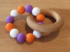 Wooden Silicone Teething Ring A beautiful natural & colourful teether that your baby will love! The wooden ring is made from natural Wooden Rings, Teething, Food Grade, Wax, Natural, Etsy, Beautiful, Wood Rings, Nature