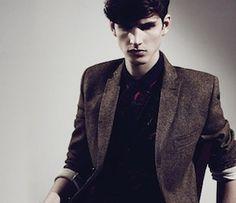 dark shirt light jacket