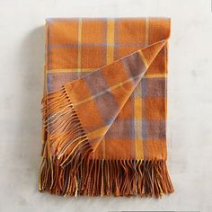 A colorful plaid comes together to create our lightweight, fringed throw that has a hue to match every decor. From snuggling in for movie night to artfully draping it over the sofa, there are a million ways to love this plaid throw.