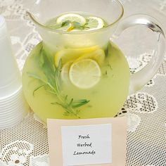 Fresh Herbed Lemonade  1 3/4 cups white sugar  8 cups water  1 1/2 cups fresh squeezed lemon juice (from 8-12 lemons)  2 lemons, thinly sliced and seeded  1-2 springs each of fresh herbs of your choice (rosemary, thyme, mint, basil or combo)