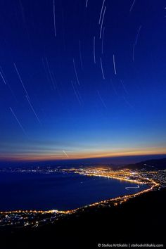 Startrail shot of Menissian Gulf at night with Kalamata city in the background Photograph Starry Gulf by Stelios Kritikakis on Places To Travel, Places To Go, Travel Destinations, Voyage Europe, Paradis, Beautiful Places To Visit, Greece Travel, Wonders Of The World, Adventure Travel