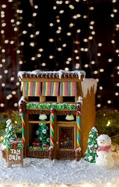 Our Victorian Storefront Gingerbread House brings the magic of a historic downtown to your house! Download our free template to make this cute toy store! It\'s competition worthy but its boxy design makes construction simple. #gingerbreadhouse #holidayinspiration #Christmas