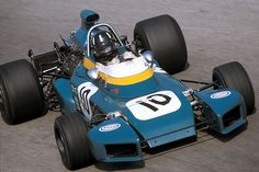 Odd car of the wing era without a wing- not sure the story here, the rest of the season it did not run like this. Monza 1971 . Graham Hill , Brabham BT34 Ford.