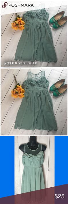 """Anthropologie. Mint dress. Small. Anthro dress by Ryu.  Anthropologie mint green. Possibly a sea foam.  Pastel color.  Seahawk style.  Size small.  Used but in good condition.  Lining with sheer overlay.  One small side zipper.  Asymmetrical pleated style bow.  Waiste 14"""" Chest 16"""" Hips 17.5"""" Length 33"""" Anthropologie Dresses"""
