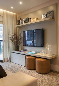 Principles of design: Balance: This could at first appear to be symmetrical, but when you look at all the elements, such as the drawers on the left & the ottomans on the right, it makes it broken up more so it's not in such tight symmetry. Harmony: The shelf above the t.v. is repetitive by having the books, but then the room gets more variety by adding in the plant by the t.v. and the yellow ottomans.: