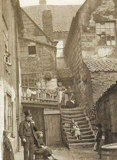 Arguments Yard, Whitby. England. Look at how those stone steps are worn down. How old were they, I wonder.