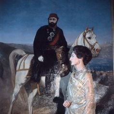 H.H. Princess of Berar in her London House, posed in front of painting of the Sultan Abdul Aziz, painted by her father, the last Caliph of Turkey, and she is wearing a necklace of Turkish diamonds which belonged to her grandmother. .. photograph by Beaton