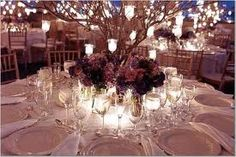 Low centerpiece with branches and candles