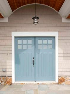 This door in Behr's Olso Blue  makes a great complementary pairing with the warm neutral palette of the surrounding house, shown on DIYNetwork.com.