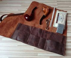 We offer Standard shipping service and Express service ,you could choose it in optional menu when you check out. Thank you . This genuine leather pouch is perfect to keep in order your pipe, cigars and accessories. This leather pouch can fit two pipes and accessories or one pipe and several