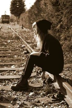 Hey let's sit on these tracks while a train is coming and take a picture. It will make me look so hipster: