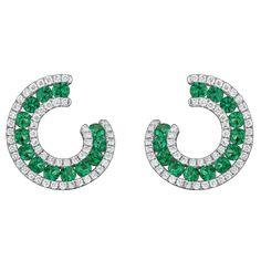 Ideal color emerald and bright diamonds in a earlobe hugging swirl