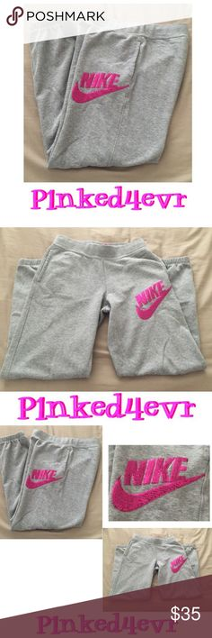 Gray Nike Sweats Pink Sequined SWOOSH XS Gray Nike Sweats Pink Sequined SWOOSH XS. Banded bottoms and drawstring waist. In excellent like new condition with no flaws whatsoever. Could also fit a small Nike Pants Track Pants & Joggers