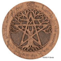 "Pentacle and tree on a wooden plaque. ""Thee I invoke by the moonlit sea by the standing stone and the twisted tree."""