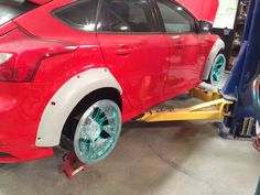 Custom widebody flares for Project Ford Focus ST with KW AgencyPower Niche wheels