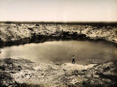 A huge bomb crater at Messines Ridge in Northern France, photographed soon after the end of World War One, circa March 1919. This image is from a series documenting the damage and devastation that was caused to towns and villages along the Western Front in France and Belgium during the First World War.