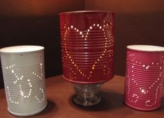 PUNCHED TIN CANS CANDLE HOLDERS... Ooooh ideas are streaming!