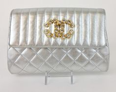 Chanel Quilted Leather Cross Body Metallic Silver Clutch. Get the trendiest Clutch of the season! The Chanel Quilted Leather Cross Body Metallic Silver Clutch is a top 10 member favorite on Tradesy. Save on yours before they are sold out!