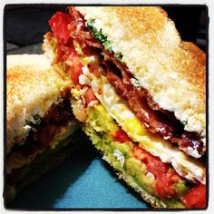 The Ultimate Bacon Sandwich by The Blonde Can Cook.... Bacon, Egg, Avocado, Tomato, Cream Cheese, and Green Onion on two perfectly toasted Italian bread slices.