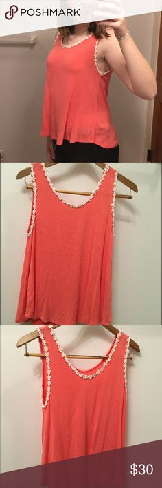 Daisy Trim Tank A coral pink tank top with adorable daisy trim. The top has a super soft ribbed texture and flowy form. It's a perfect go-to summer top. By the brand Élodie, purchased at Nordstrom bp. Worn once, wonderful condition. Open to bundles and reasonable offers. bp Tops Tank Tops