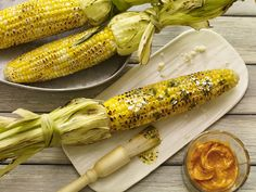 GRILLED CORN WITH CILANTRO BUTTER RECIPE Make grilled corn the star of your barbecue by brushing with Mexican inspired mesquite cilantro butter and Cotija cheese. Create a handle for holding the corn with the husks pulled back before grilling. Grilled Vegetable Recipes, Grilled Vegetables, Grilled Recipes, Grilled Food, Summer Grilling Recipes, Grilling Ideas, Cooking Recipes, Healthy Recipes, Simple Recipes