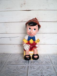 Don't lie...you know you love this!    Pinocchio Piggy Bank Play Pal Plastic Walt Disney.