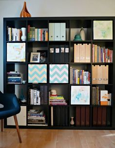IKEA Hackers: using canvas pictures on hooks to cover clutter