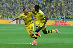 Dortmund's French midfielder Ousmane Dembele (R) reacts with Dortmund's Polish defender Lukasz Piszczek after scoring during the German Cup (DFB Pokal) final football match Eintracht Frankfurt v BVB Borussia Dortmund at the Olympic stadium in Berlin on May 27, 2017. / AFP PHOTO / Tobias SCHWARZ / RESTRICTIONS: ACCORDING TO DFB RULES IMAGE SEQUENCES TO SIMULATE VIDEO IS NOT ALLOWED DURING MATCH TIME. MOBILE (MMS) USE IS NOT ALLOWED DURING AND FOR FURTHER TWO HOURS AFTER THE MATCH…