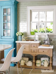 Love the table used as a baking station in the kitchen